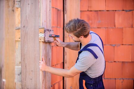 Use hammer. Worker with hammer brick wall background. Building and construction. Engineer with hammer tool. General maintenance and repair workers are hired for maintenance and repair tasks