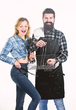 Family weekend. Couple in love hold cooking utensils for barbecue. Tools for roasting meat outdoors. Picnic and barbecue. Culinary concept. Man bearded hipster and girl ready for barbecue party Banco de Imagens - 133050644