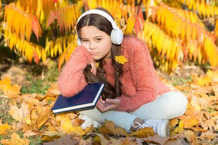 Self education concept. Child enjoy reading. Visual and audio information. Schoolgirl study. Study every day. Girl read book autumn day. Little child enjoy learning at backyard. Kid study with book Stockfoto