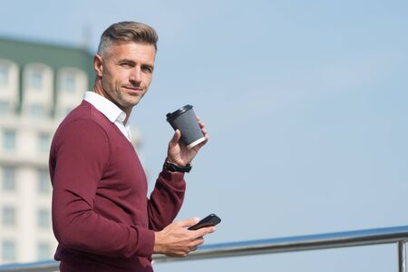 Coffee on the go. Handsome man hold takeaway coffee. Mature businessman drink coffee on urban outdoor. Enjoying fresh coffee. Take break from work, copy space