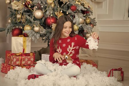 little child girl likes xmas present. The morning before Xmas. New year holiday. Christmas. Kid enjoy the holiday. Happy new year. small happy girl at christmas. By golly, be jolly. let it snow Stock Photo