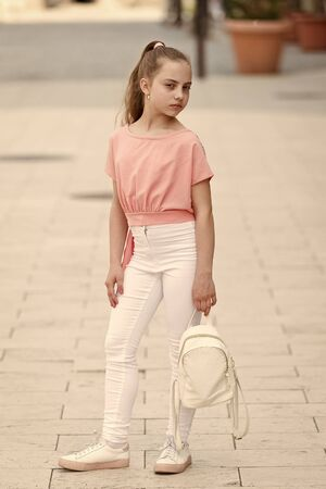 Cute and stylish. Adorable girl of fashion on summer day. Fashionable girl child on city street. Small girl with beauty look. Little girl with long blond hair in casual fashion style