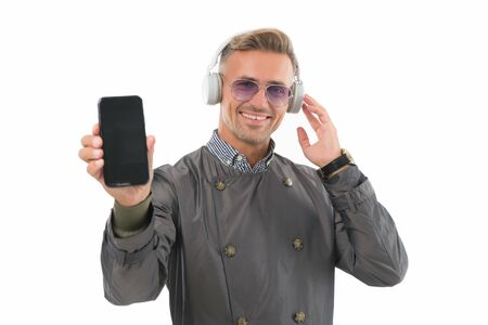 Modern phone. Lifestyle blogger. Handsome well groomed man creating content for personal blog. Online blog. Digital influencer concept. Video call communication. Personal blog social networks Stock Photo