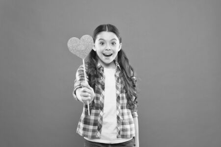 Vote for love. Girl little child hold heart symbol on stick. Like and support. Valentines day. Fall in love. Love will save the world. Kid promoting love. Personal attitude. I definitely like this