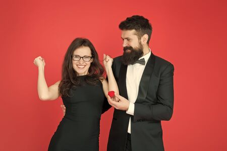 finally. valentines day celebration. happy sexy couple in love. tuxedo man and lady at engagement celebration. bearded man make woman marriage proposal. formal couple. ring in box. love date. yes