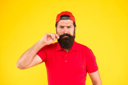 Feeling awesome. Moustache grooming guide. Hipster handsome guy touching moustache. Tips for growing and maintaining moustache. Man bearded hipster twisting mustache yellow background. Barber salon