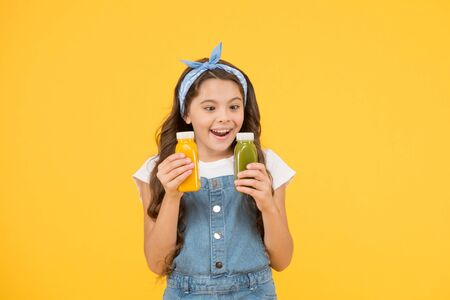 Because juice tastes good. Happy small child hold bottles of juice. Little girl enjoy drinking fruit juice. Juice as healthy part of childs diet