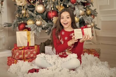 delivery christmas gifts. happy new year. happy little girl celebrate winter holiday. christmas time. Cute little child girl with xmas present. Thank you. Dear santa