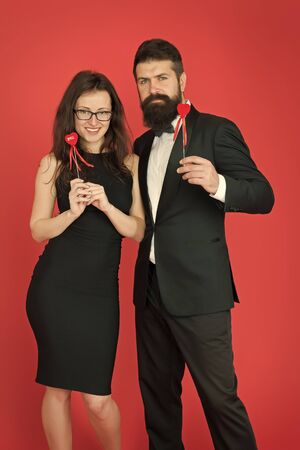 formal couple. business meeting. tuxedo man and formal woman at formal party. couple in love. valentines day heart. bearded businessman with formal lady. love date and romance. business couple