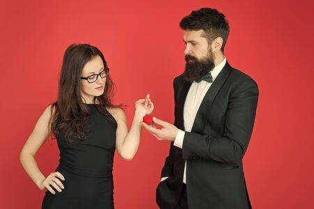 tuxedo man and elegant lady at wedding party. formal couple. ring in box. love date and romance. bearded man make woman marriage proposal. valentines day. sexy couple in love. wedding party