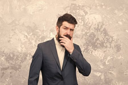 Touching his perfect beard. Getting perfect shape. Tailor or fashion designer. Modern life. Male fashion model. Mature businessman. Brutal bearded hipster in formal suit. elegant man with beard 版權商用圖片