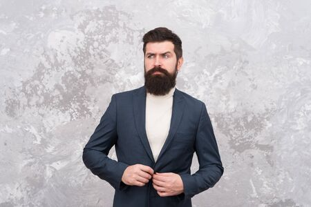 Tailor or fashion designer. elegant man with beard. Male fashion model. Mature businessman. Modern life. Brutal bearded hipster in formal suit. Grooming of real man. It is time for grooming