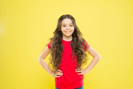 Wind can also damage hair. Girl adorable kid long wavy hair yellow background. Strong persistent winds can create tangles and snags in wavy and curly long hair. Things you doing to damage your hair