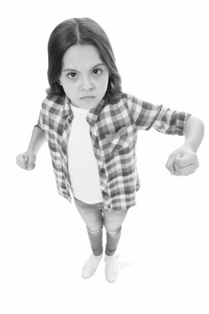 Stop bullying movement. Girl kid threatening with fist. Strong personality temper. Threaten with physical attack. Kids aggression concept. Aggressive girl threatening to beat. Threatening violence Archivio Fotografico - 133196419