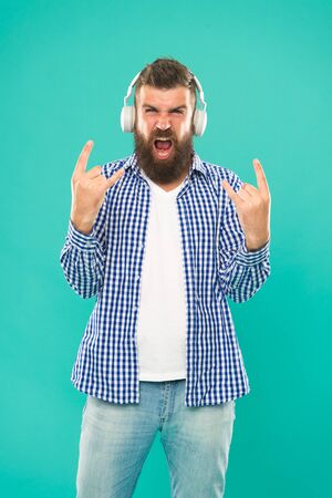 Heavy metal and hard rock. Streaming music sites. Wireless technology. User friendly interface and large library of tunes. Hipster with beard listening music. Handsome music lover. Man in headphones Stockfoto