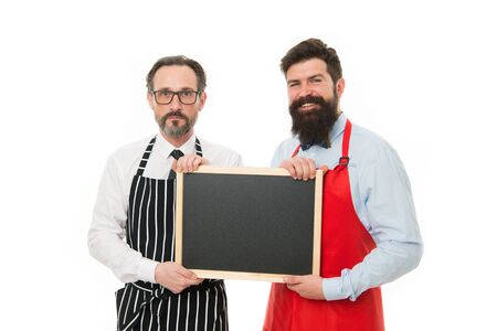 Men bearded bartender or cook in apron hold blank chalkboard. Bartender with blackboard. Hipster bartender show blackboard copy space. Bar cafe staff. Hiring staff. Men bearded hipster informing you