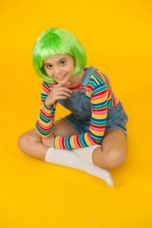 Create new look in salon. Happy girl with beauty look. Little child wear green hair wig in fancy style. Beauty and hair salon. Fashion salon. Salon or parlor. Color and style hair using creativity