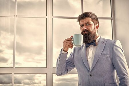 But first coffee. Man groom drinking coffee early in morning. Beginning of great day. Important day in his life. Get ready. Enjoy every minute. Hipster in tuxedo with bow tie making sip of coffee