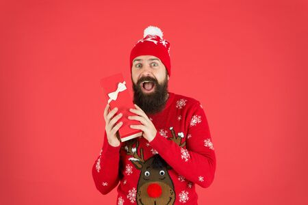 Find presents online. happy new year. cheerful bearded man after shopping. man in hat. winter holidays. his favorite sweater. merry christmas. got xmas gift. seasonal discounts. present from santa