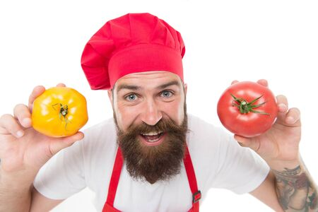 Tomato diet. Happy chef cook with tomato vegetables. Bearded man cook hold tomato in hands isolated on white. Tomato salsa or ketchup. Gazpacho. Mediterranean cuisine. Healthy cooking and eating