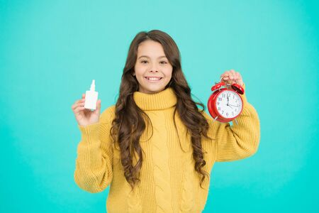 Time to take medicines. Runny nose and symptoms of cold. Kid use effective medicines. Girl hold nasal drops. Allergy concept. Home treatment. Nasal drops plastic bottle. Effective nasal spray
