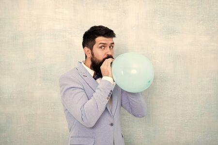 Man groom blue tuxedo bow tie hold air balloon. Wedding fun. Groom bearded hipster having fun with air balloon. My happy day. Happy guy in cheerful mood. Fun and happiness concept. Lets have fun