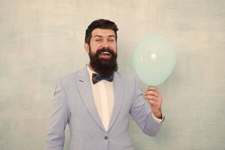 Lets have fun. Man groom blue tuxedo bow tie hold air balloon. Wedding fun. Groom bearded hipster having fun with air balloon. My happy day. Happy guy in cheerful mood. Fun and happiness concept Stock Photo