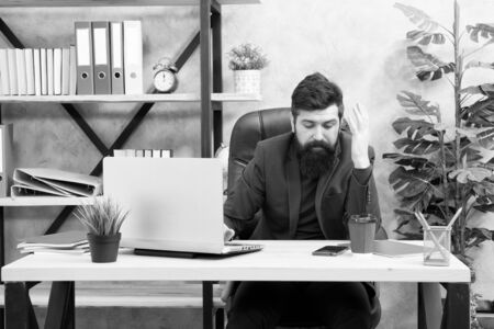 Business communication. Digital device. Businessman in formal outfit. Confident man use laptop phone. Boss workplace. Bearded man in business office. communication technology. communication online