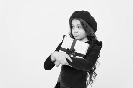 Shopping mall. boxing day. parisian girl in french beret go shopping. autumn fashion. school fall season. greedy small girl with present box. small girl hold holiday gift. happy birthday. copy space