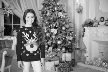 delivery christmas gifts. happy new year. happy little girl celebrate winter holiday. christmas time. Cute little child girl with xmas present. Christmas composition Stock Photo
