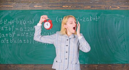 Experienced educator start lesson. She cares about discipline. Woman teacher hold alarm clock. Girl formal wear school lecturer. What time is it. Lessons schedule. Welcome teacher school year