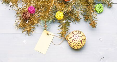 Get ready for christmas. Christmas decorations wooden background top view. Everything you need to decorate christmas tree. Christmas holidays concept. Decorative ball toy and gift tag copy space