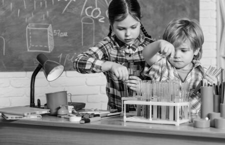 School chemistry laboratory. back to school. Science and education. chemistry lab. happy children. Laboratory Research - Scientific project For Chemical test. Breathing life into chemistry Zdjęcie Seryjne