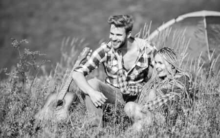 Camping in mountains. Couple in love happy relaxing nature background. Boyfriend girlfriend guitar near camping tent. Fresh air and pure feelings. Summer vacation. Camping vacation. Hiking romance Reklamní fotografie