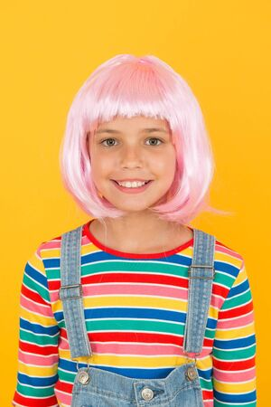 New smile new look. Little girl smile in short pink hair wig. Happy child smile yellow background. Small kid with white healthy smile. Art of dentistry. Dental care you can trust