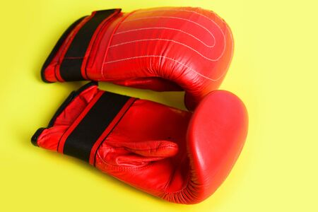 Strong sports equipment concept with juicy red boxing gloves
