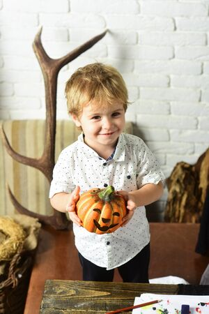 Magician with blond hair makes Halloween decorations