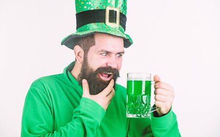 Irish tradition. Man brutal bearded hipster drink pint beer. Green beer mug. Drinking beer part of celebration. Irish pub. Alcohol consumption integral part saint patricks day. Discover culture