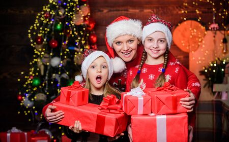 Wonderful moments christmas. Achieve impeccable christmas day. Little girls with lot gift boxes. Christmas morning routine for moms. Mom hug daughters near christmas tree. Happy family concept