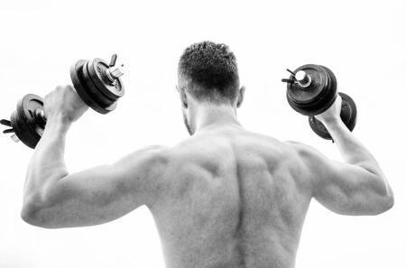 man sportsman weightlifting. steroids. athletic body. Dumbbell gym. fitness and sport equipment. Muscular back man exercising in morning with barbell. Healthy lifestyle. Never give up and keep moving.