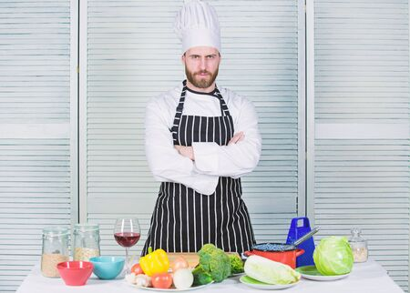 Dieting and vitamin. culinary cuisine. organic vegetarian. cook in restaurant, uniform. professional chef cooking in kitchen. bearded man loves healthy food and wine. healthy food only. Kitchenware