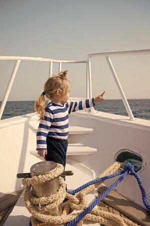 Baby boy enjoy vacation sea cruise ship. Child sailor. Boy sailor travelling sea. Boy sailor striped shirt sea yacht travel around world. Little sea traveller. Beach is calling and we must go