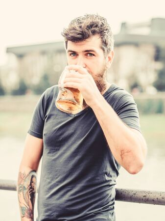 Man drinking beer. Bearded man with beer glass outdoor. brutal male needs refreshment. drink alcoholic beer beverage. weekend relax. Mature hipster with beard hair drinking beer Stockfoto