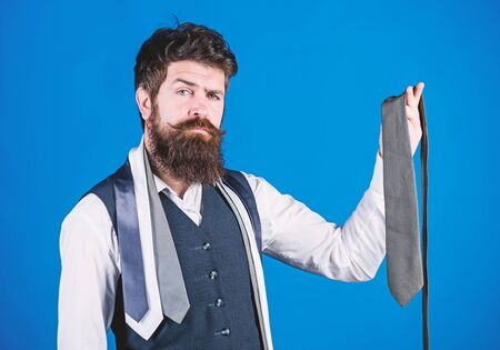 Matching his clothing style. Businessman in classic style. Bearded man choosing the right necktie for business life style. Brutal hipster wearing formal style with collection of ties