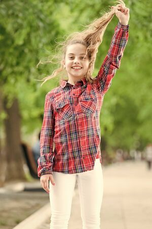 Feeling cozy and comfortable on windy day. Deal with long hair on windy day. Hairstyles to wear on windy days. Windproof hairstyles. Girl little cute child enjoy walk on windy day nature background