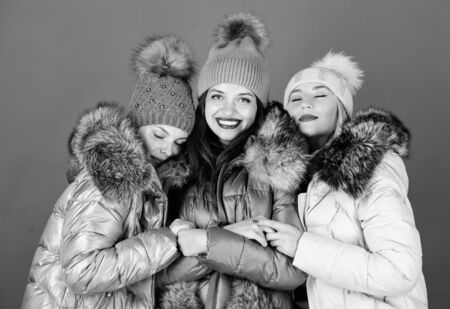 seasonal shopping. happy winter holidays. Friendship. winter clothing fashion. faux fur down jacket. women in padded warm coat. family christmas.