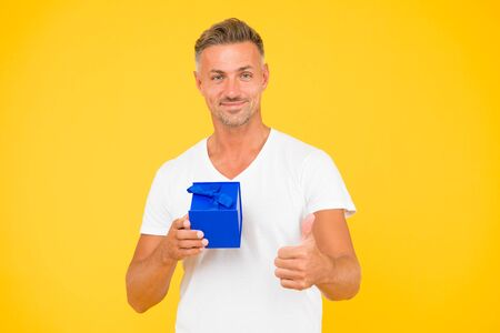 best offer. goods for men. for his beloved. mature man gift box. unshaven macho man yellow background. present from heart. gift with love. happy birthday. man happy face celebrate valentines day Stock fotó - 133758658