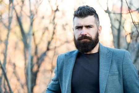 Fine grooming for modern savage. Bearded man with brutal beard. Hipster wear long beard and mustache in brutal style. Lumberjack look of modern businessman. Brutal and bearded. Barbershop