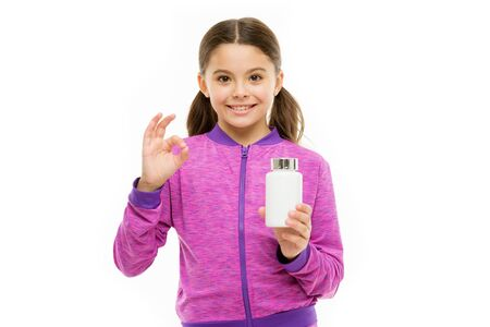 ok for kids. Eat healthy diet. pills for healthy growth. early phisical development. food additives complex. healthy sporty kid vitamin jar. Little girl happy smile. small child isolated on white Zdjęcie Seryjne