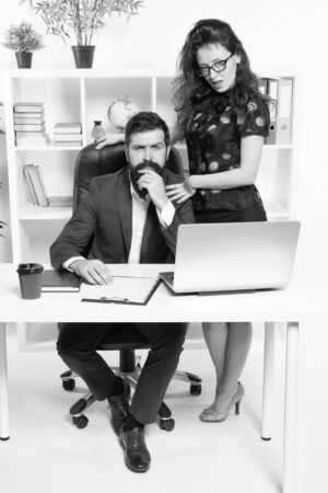 Successful business team. Man and attractive woman. Boss manager director and ceo position. Business man secretary. Job and career. Business couple working office. Business people. Couple in office Stock fotó